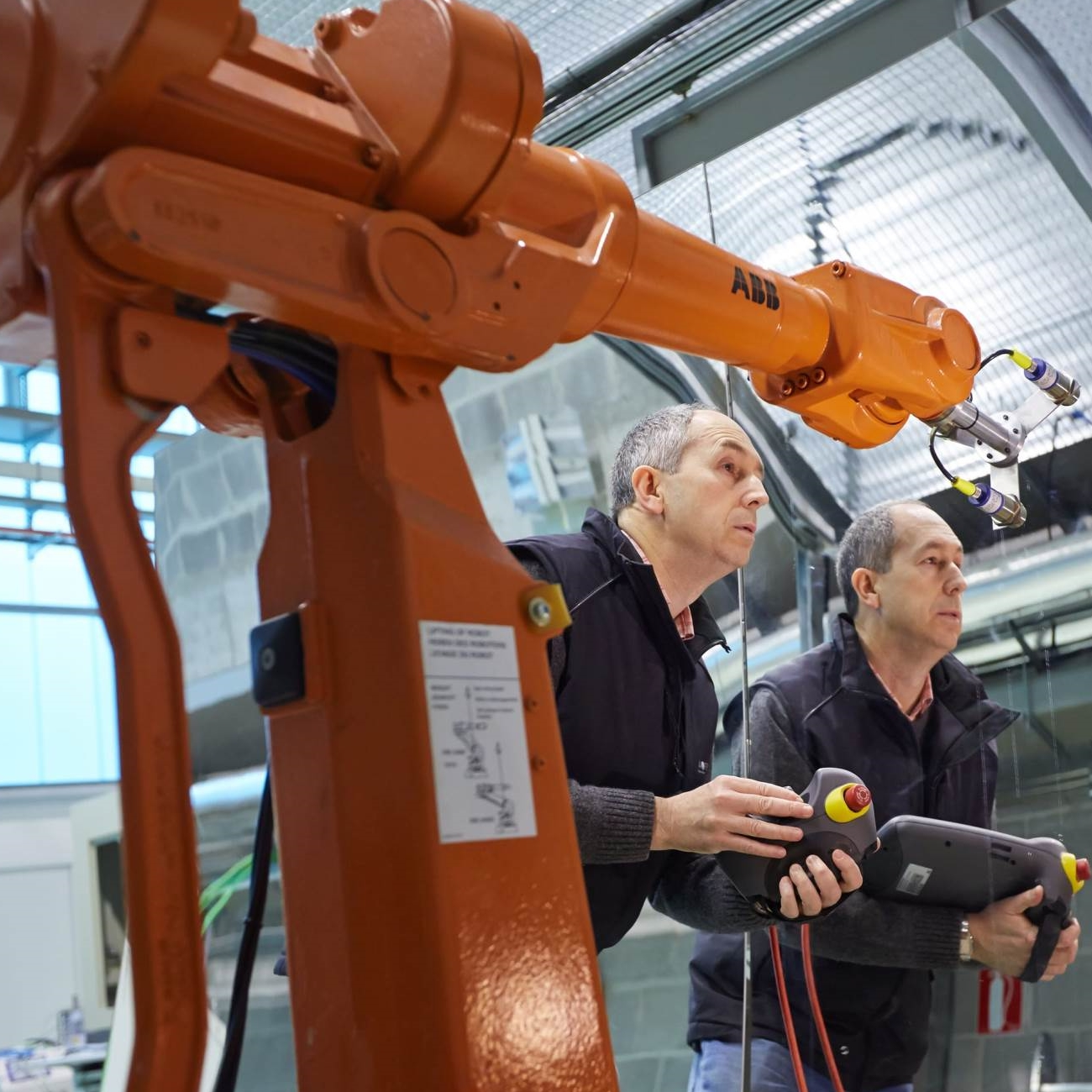 Technicians setting up an ABB industrial robot